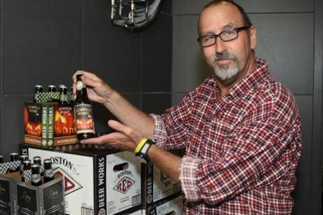 Jim Callahan, general manager for Hingham Beer Works, displays Pumpkin Works Ale, one of his brewery's most popular fall brews.